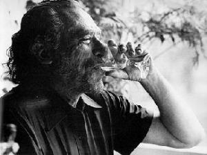 Charles Bukowski sips wine like glass shard woman